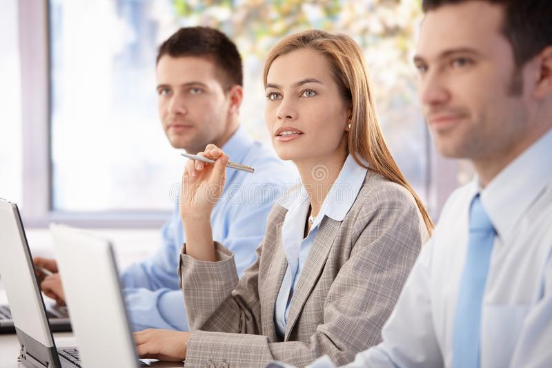 Young professionals having business training. Young, attractive professionals having business training stock photo