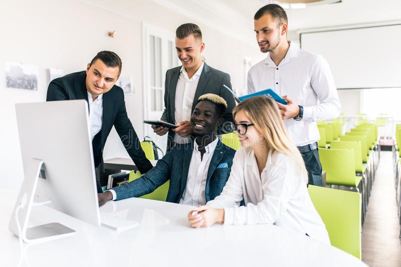 Young professionals team work in modern office. Project manager team discussing new idea. Business crew working with startup. royalty free stock images