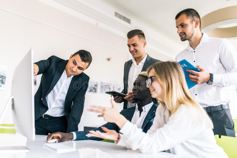 Young professionals team work in modern office. Project manager team discussing new idea. Business crew working with startup. royalty free stock photo