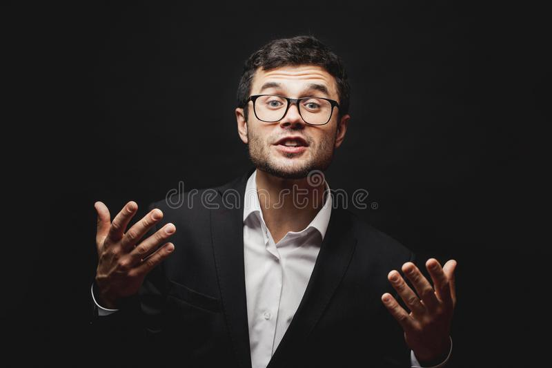 A young professor is giving propts to a student while exam stock images