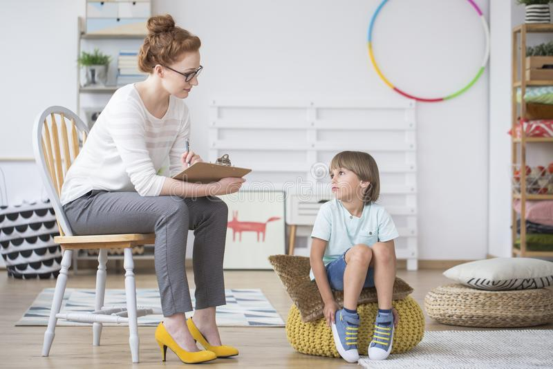 Young psychotherapist with child stock photo
