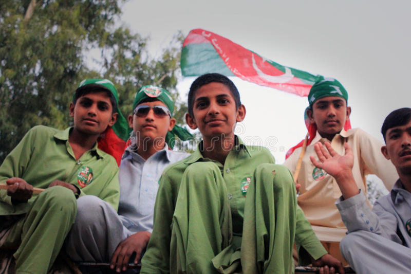 Young PTI Supporters in Karachi, Pakistan. Young Supporters of PTI wave party flags in Karachi, Pakistan on 25th December 2011. Hundreds of Thousands of People royalty free stock photo