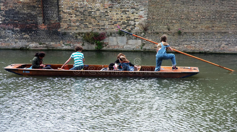 Young punter punting in Cambridge. Young punter punts the punt with her passengers in Cambridge,UK stock images