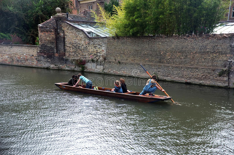 Young punter punting in Cambridge. Young punter punts the punt with her passengers in Cambridge,UK stock photography