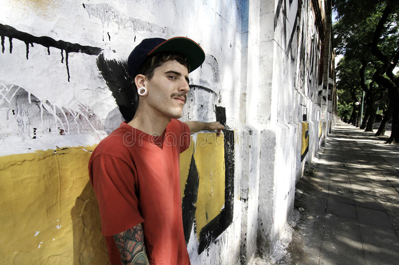 Rapper leaning on a Wall. A young Rapper leaning against a wall royalty free stock photo