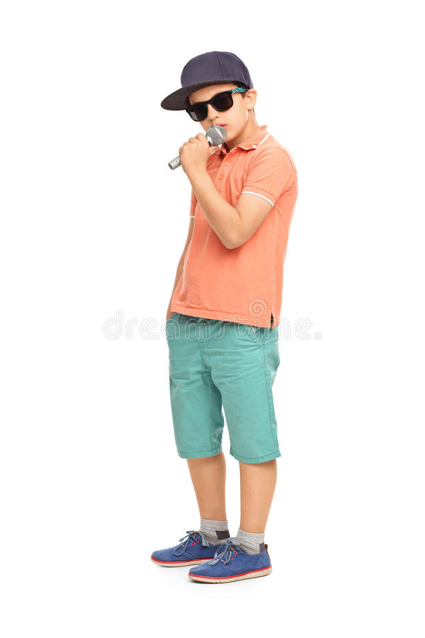 Young rapper posing with a microphone. Isolated on white background stock image