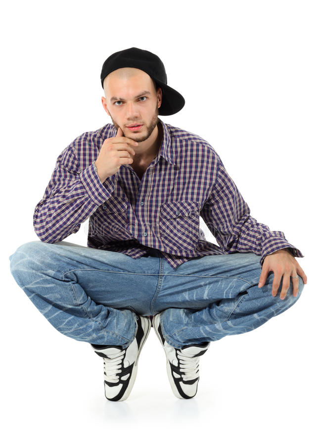 Young rapper squatting stock image