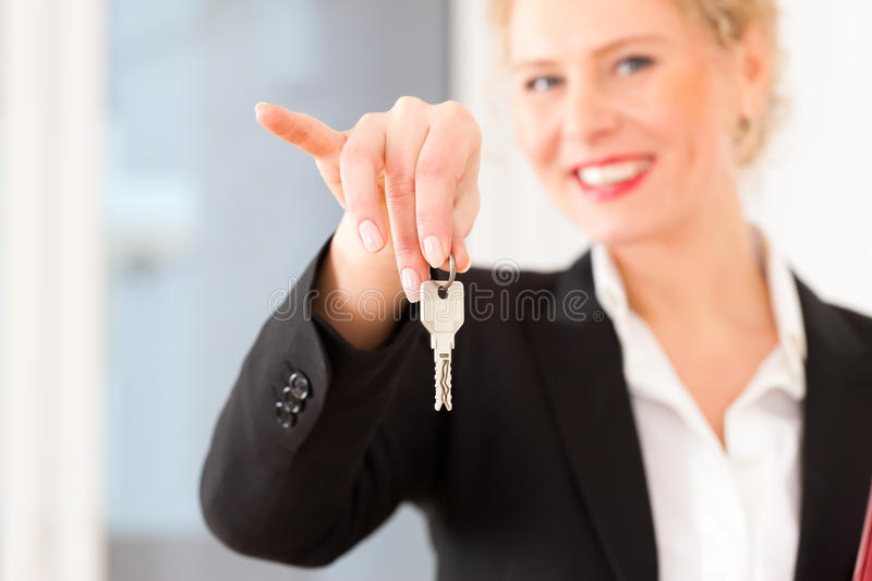 Young realtor is with keys in an apartment. It could be the tenant too stock photography
