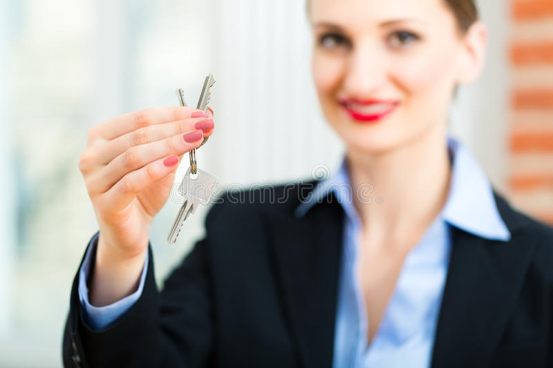 Download Young Realtor Is With Keys In An Apartment Stock Photography - Image: 30692662