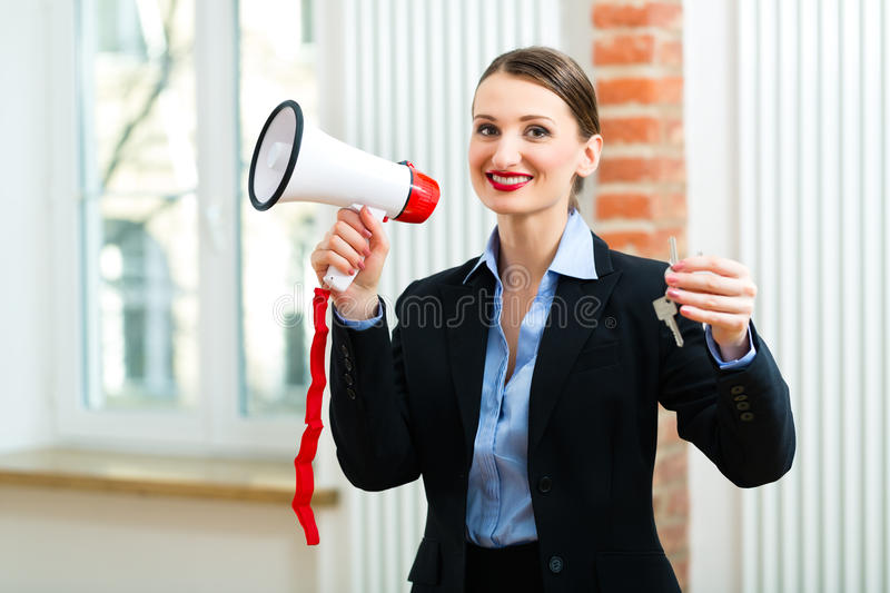 Download Young Realtor Is With Keys In An Apartment Stock Photo - Image: 29801590