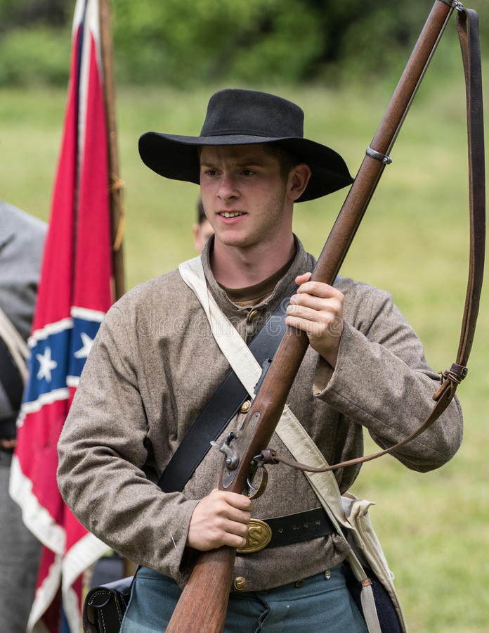 Young Rebel. A Civil War era soldier in battle at the Dog Island reenactment in Red Bluff, California stock photos