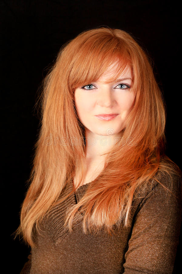 Download Young Red-haired Girl Smiling On A Dark Background Stock Image - Image: 18304017