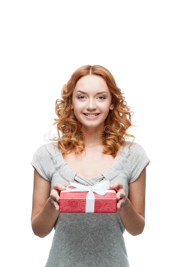Young red-haired happy smiling girl holding gift stock photography