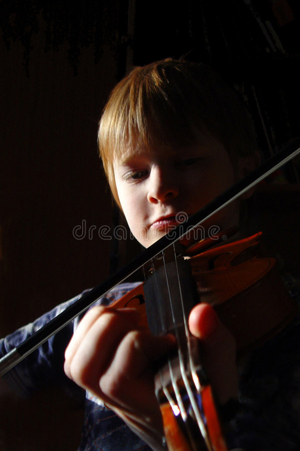Young red-haired violinist stock photo
