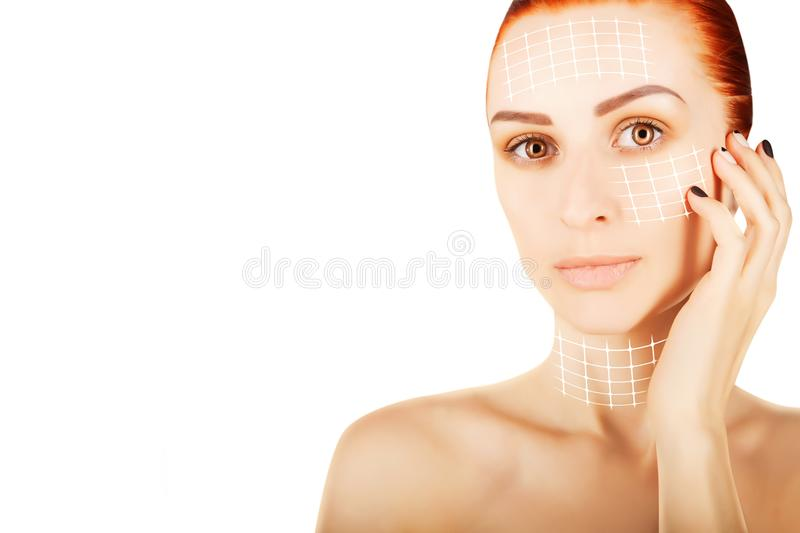 Young red haired woman closeup with surgery lines, white backgr royalty free stock photo