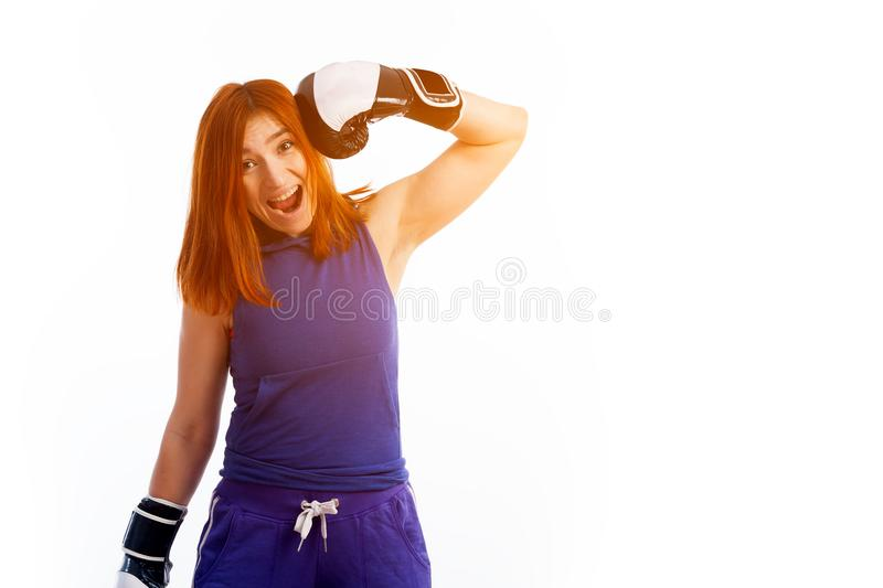 young red-haired woman boxer stock images