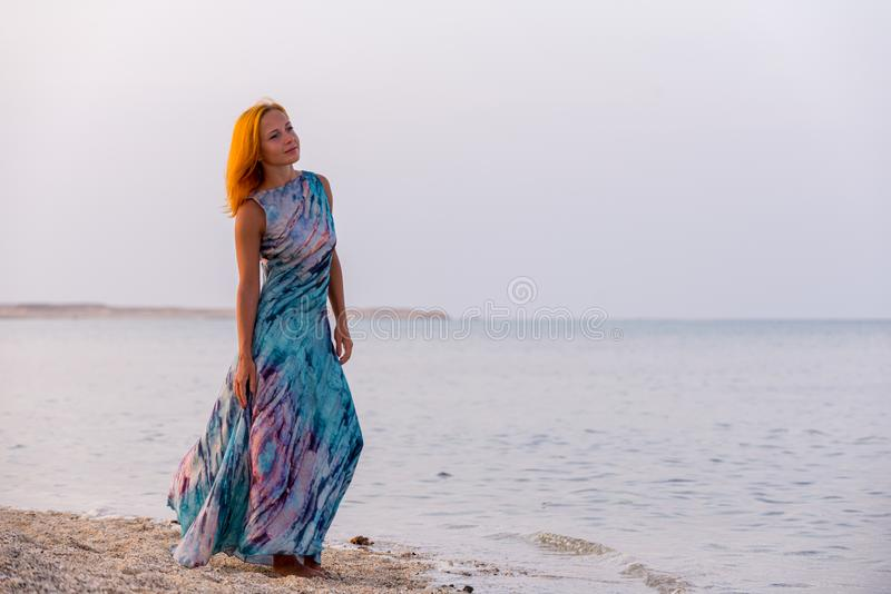 Young red woman on a beach stock images