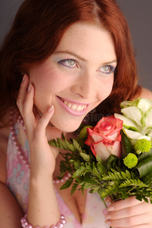 The young redhead attractive woman stock images