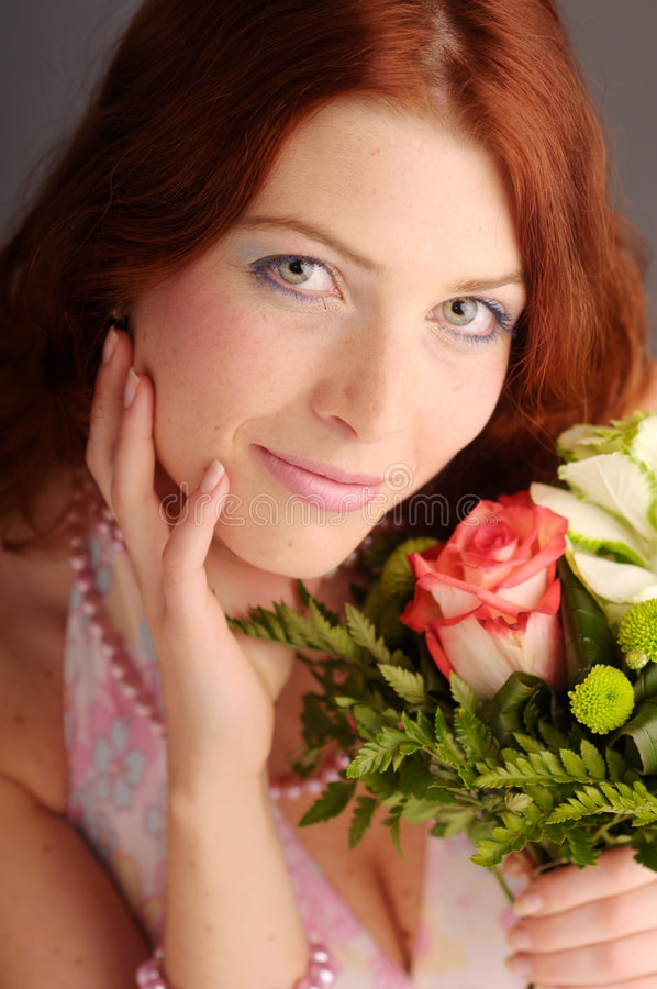 The young redhead attractive woman stock image