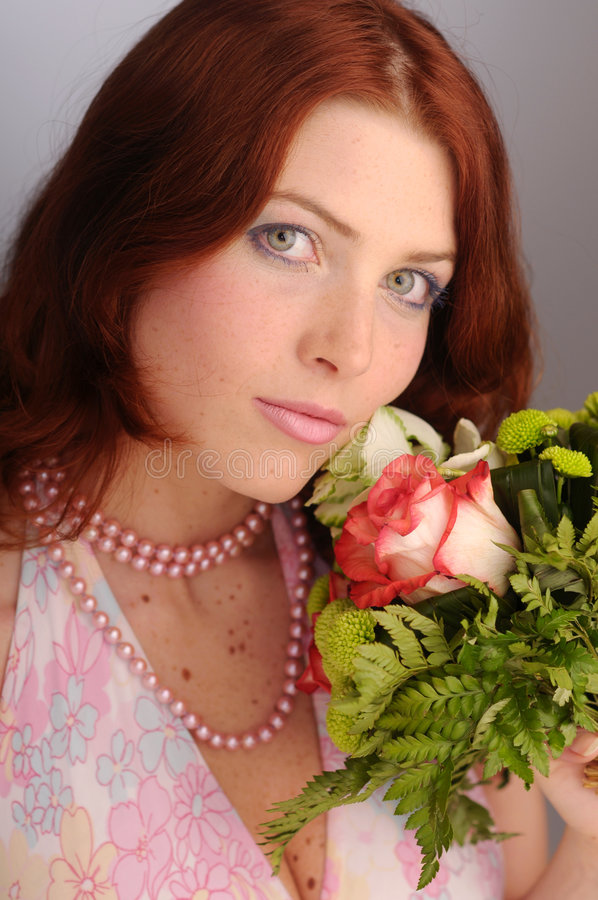The young redhead attractive woman royalty free stock photos