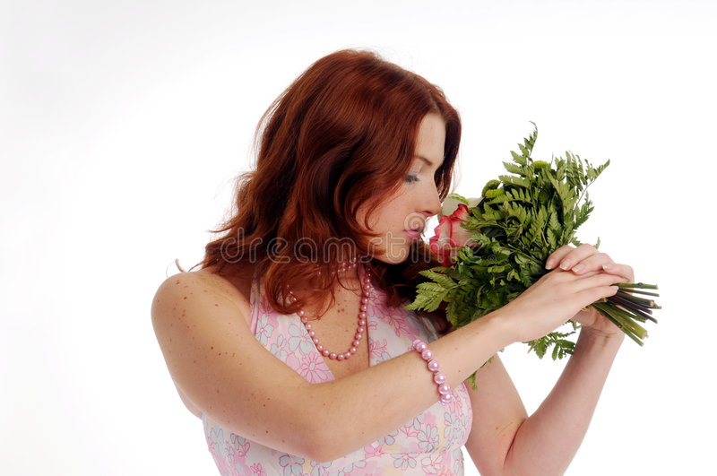 The young redhead attractive woman with rose royalty free stock photography