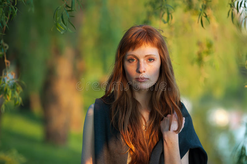 Young redhead caucasian woman serious face outdoor portrait in film retro colors stock images