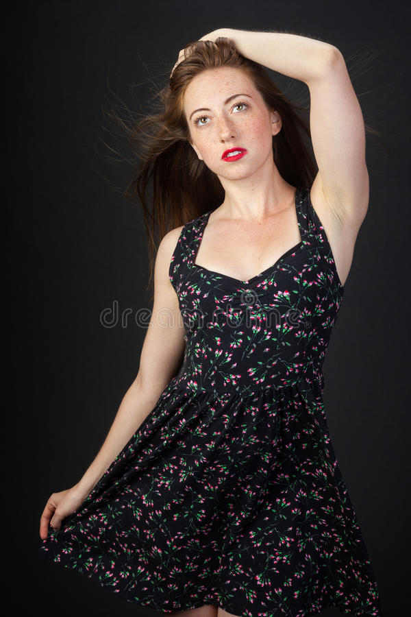Young Redhead in a Colorful Dress stock photography