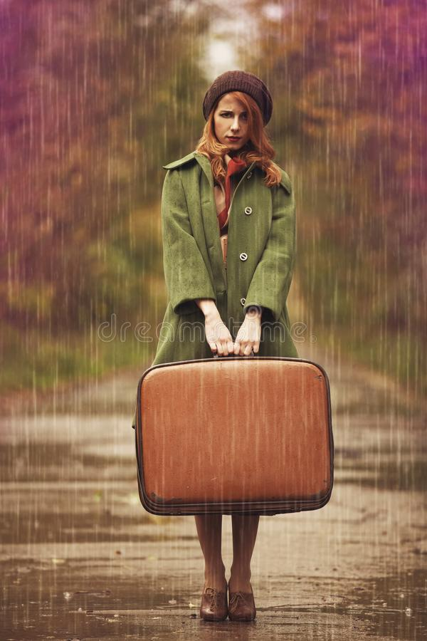 Young redhead girl in hat and coat at outdoor royalty free stock photo