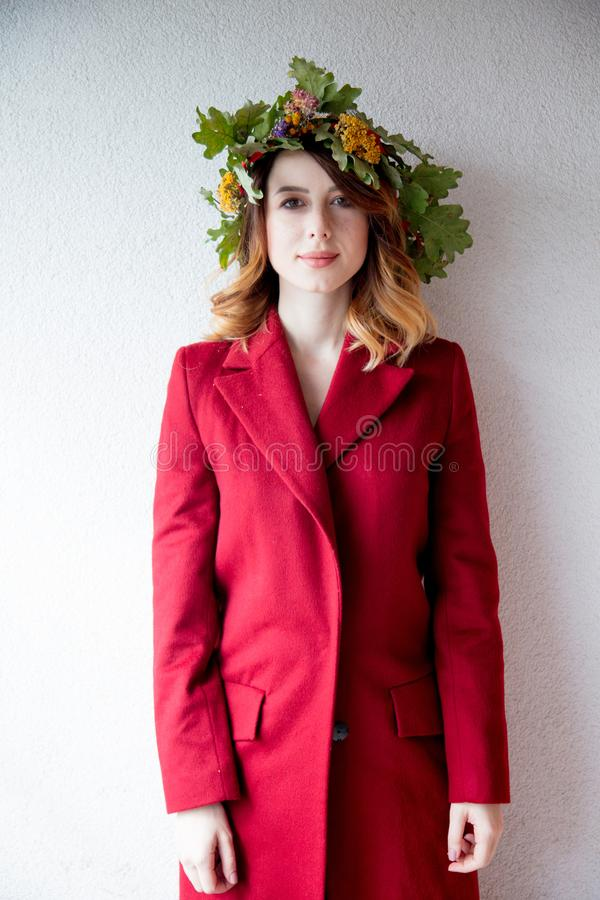 Young redhead girl with oak leaves wreath royalty free stock photos