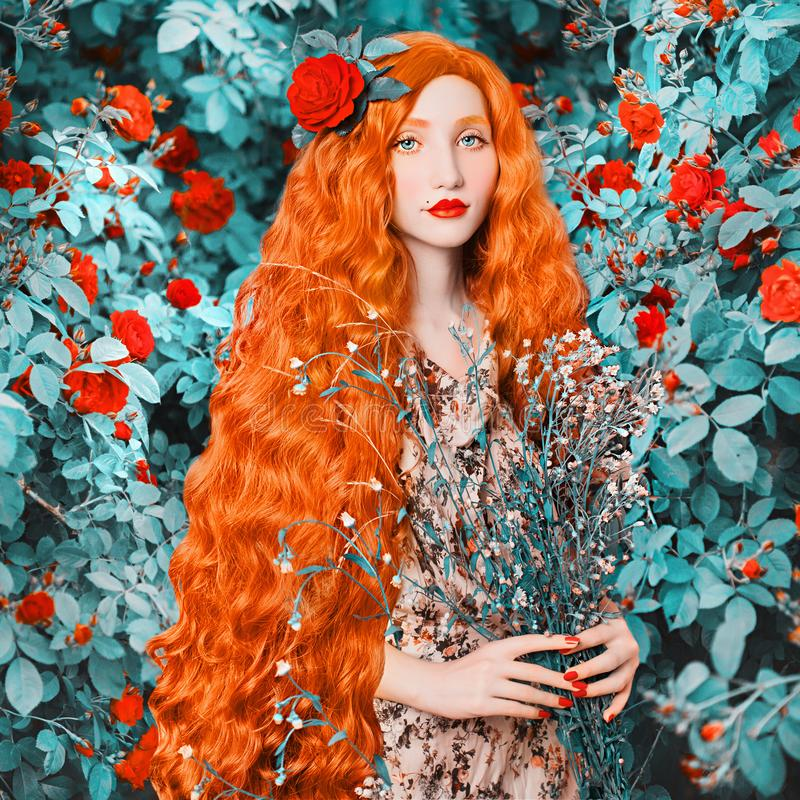 Young redhead renaissance woman in flower dress on rose background. A beautiful girl with pale skin, red lips and blue eyes. stock photography