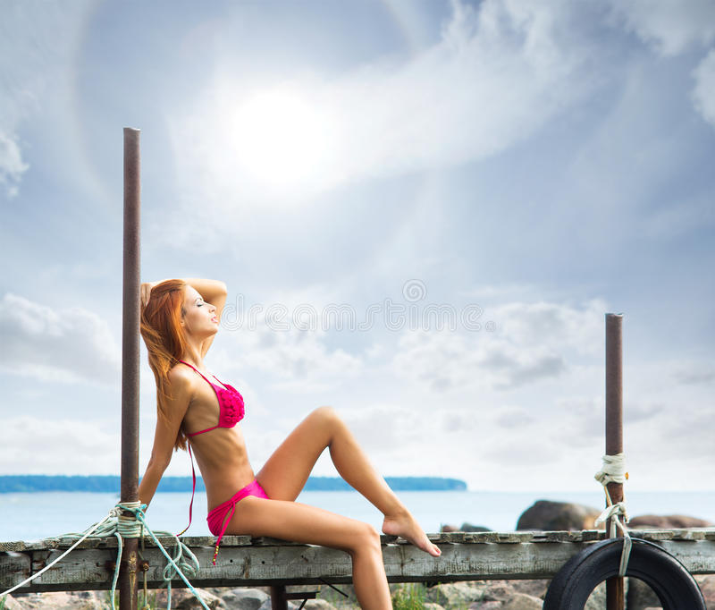Download A Young Redhead Woman Laying In A Pink Swimsuit Stock Photo - Image: 29526804