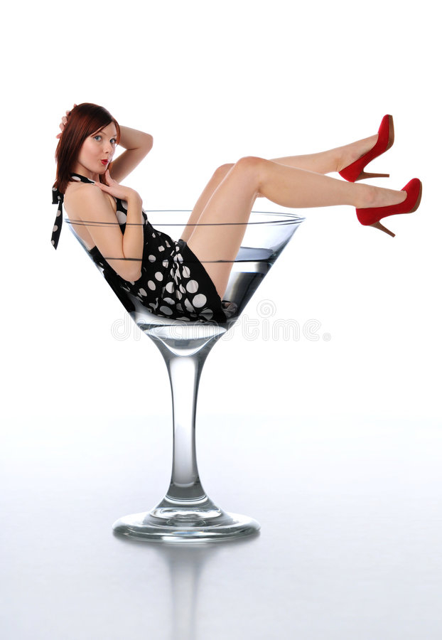 Young redheard woman in a martini glass. Young redheaded woman in a martini glass royalty free stock photography