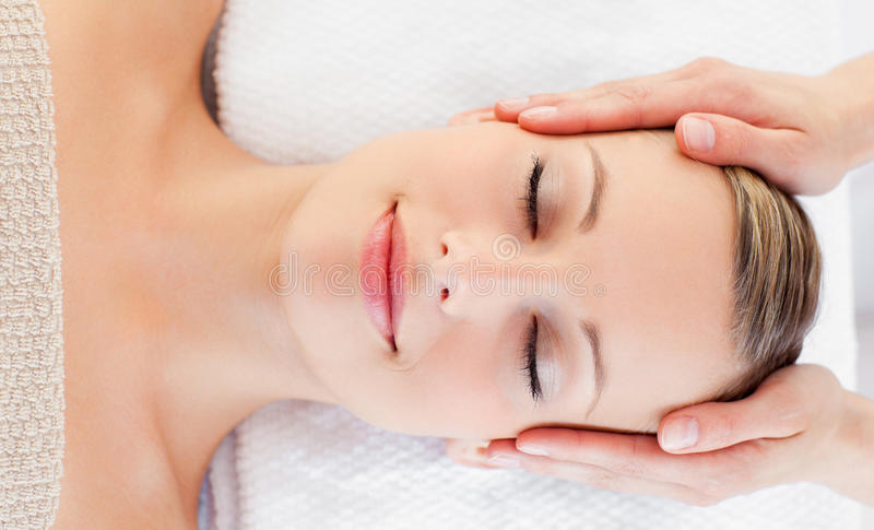 Young relaxed woman receiving a head massage royalty free stock photos