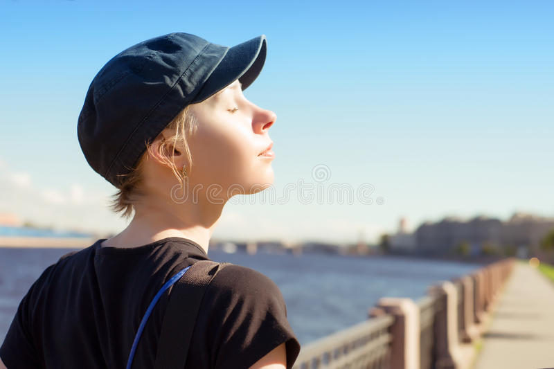 Young relaxing woman at sunny day stock image