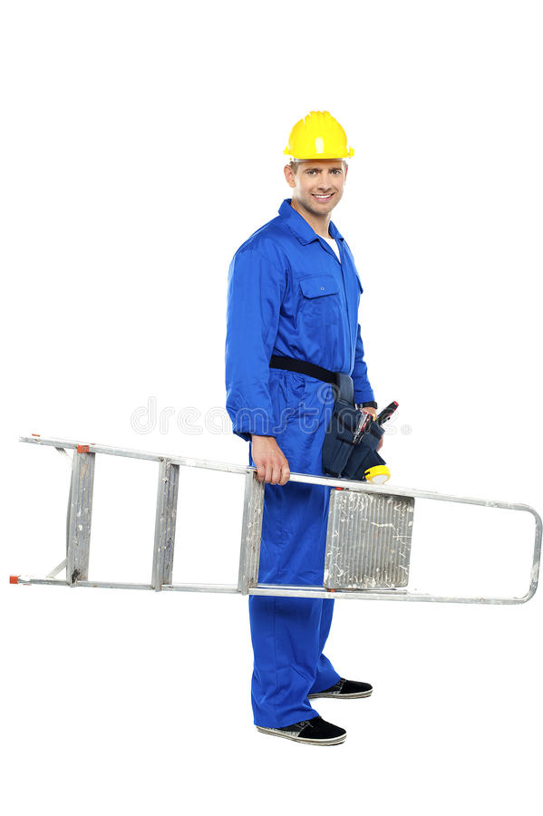 Download Young Repairman Ready With Stepladder Royalty Free Stock Photos - Image: 26683718