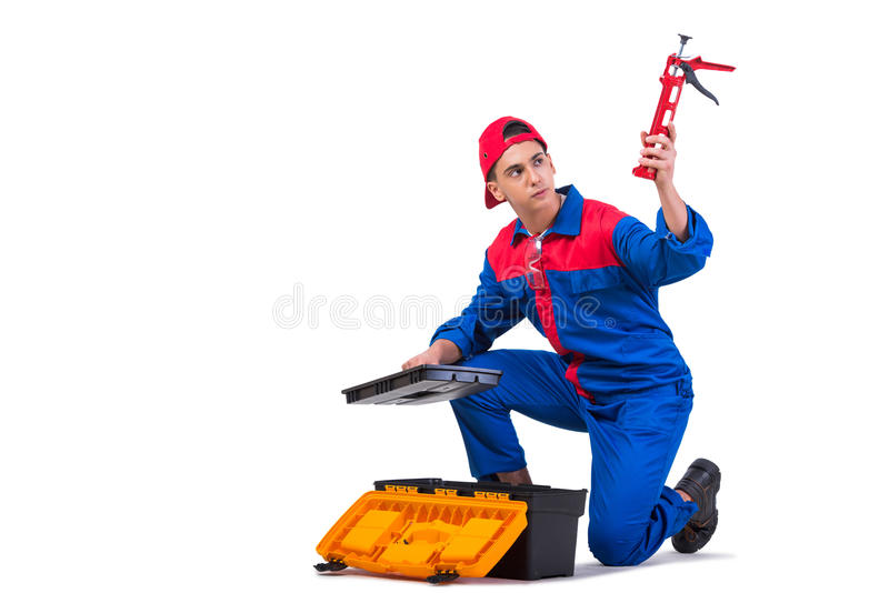The young repairman with silicone gun isolated on white royalty free stock image