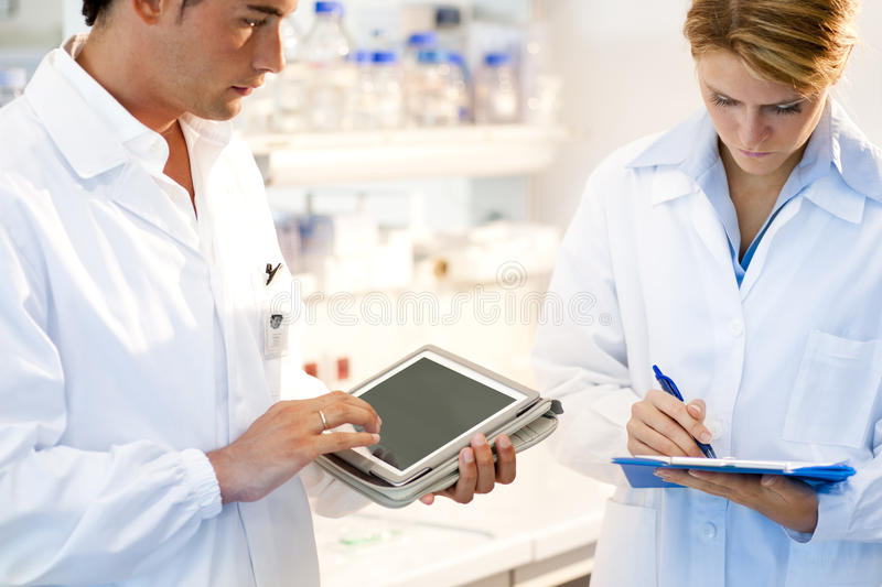 Download Young Researcher Using Tablet PC Stock Image - Image of selectove, personal: 22127917
