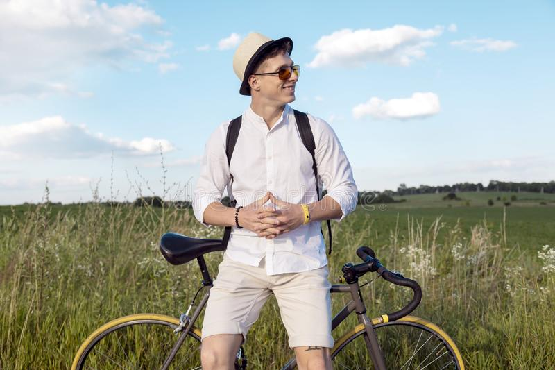 Resting Contented Cyclist on a Countryside Road stock photos