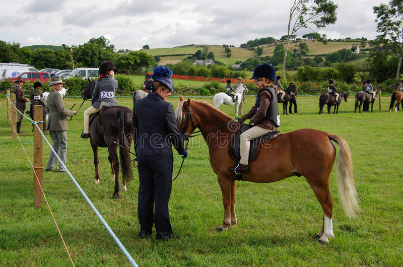 Young riders in the ring. Young horse riders in the ring for the in hand class at the North Lonsdale Agricultural Show stock photo