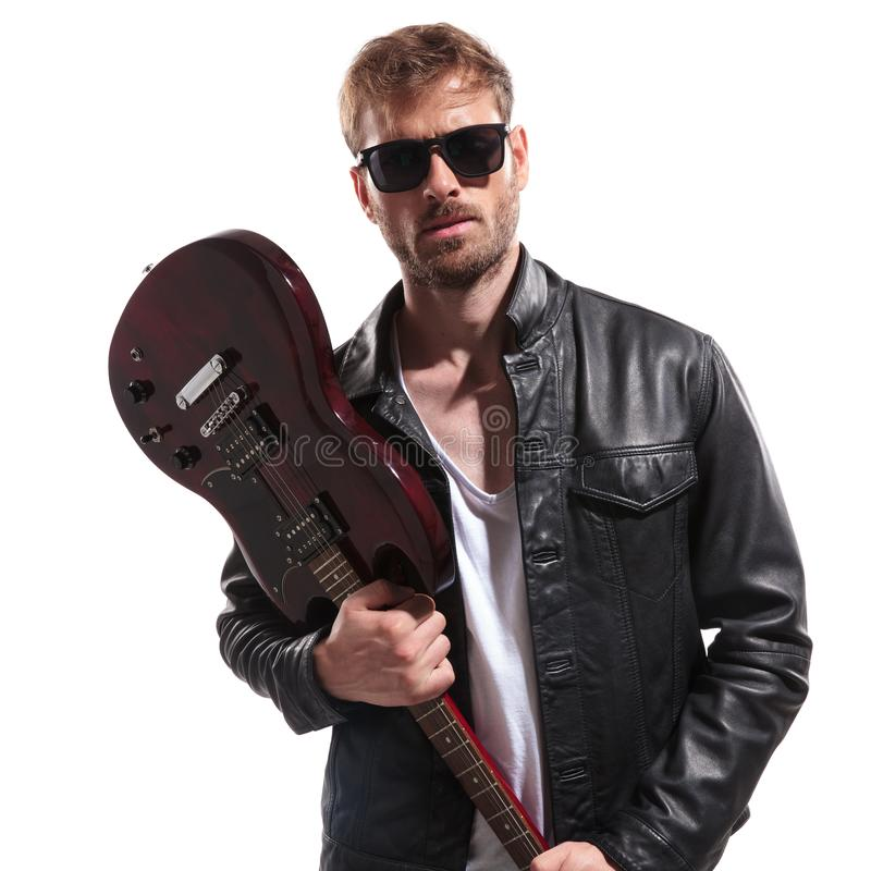 Young rock star wants to smash his electric guitar royalty free stock images