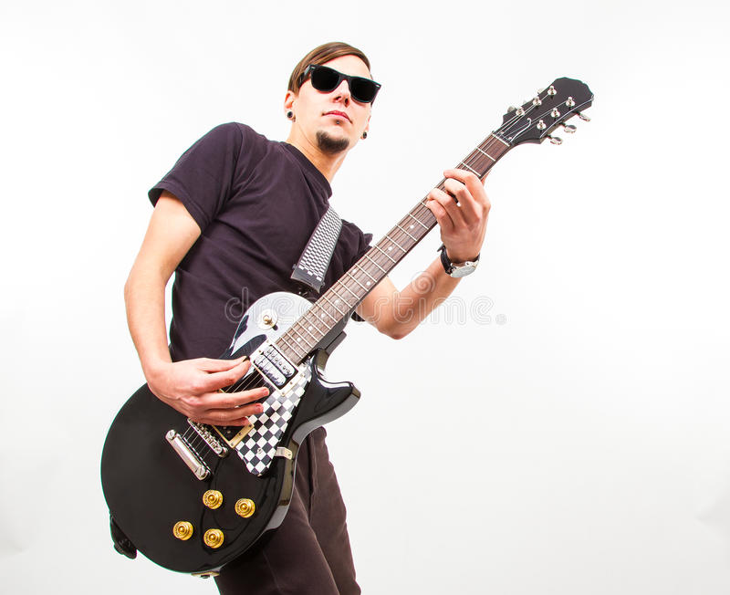 Young Rockstar Playing On Guitar Stock Photo