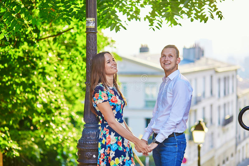 Young romantic couple having a date in Paris, France. Young romantic couple having a date on a street of Montmartre in Paris, France royalty free stock photos