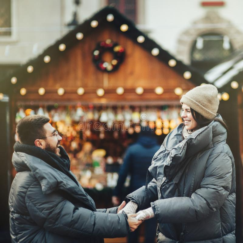Winter holidays. Young beautiful happy smiling couple posing on royalty free stock images