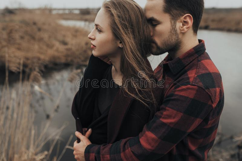 Young romantic couple is kissing and enjoying the company of each other. stock photography