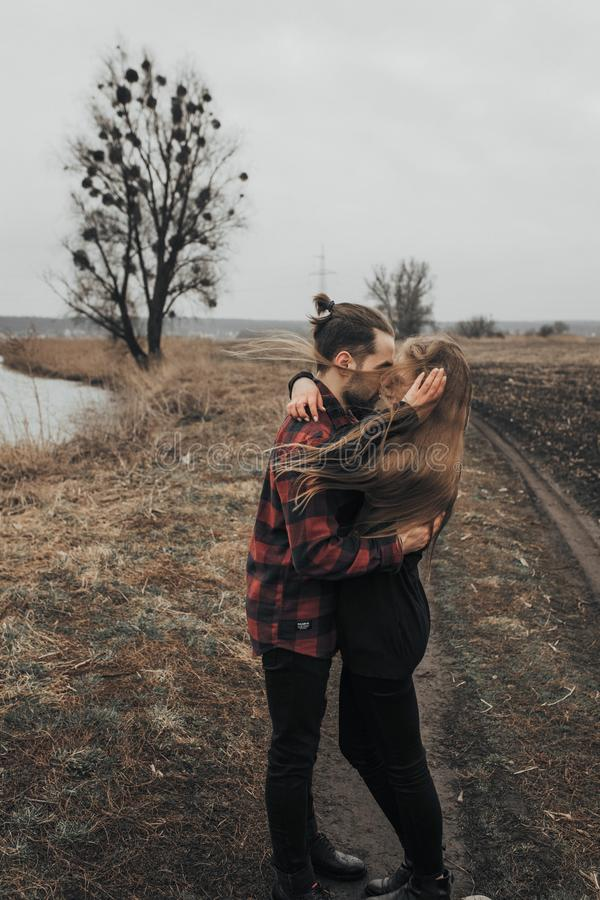 Young romantic couple is kissing and enjoying the company of each other. royalty free stock photo