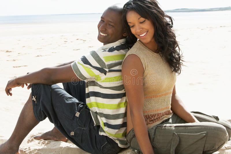 Young Romantic Couple Relaxing On Beach Together royalty free stock photos