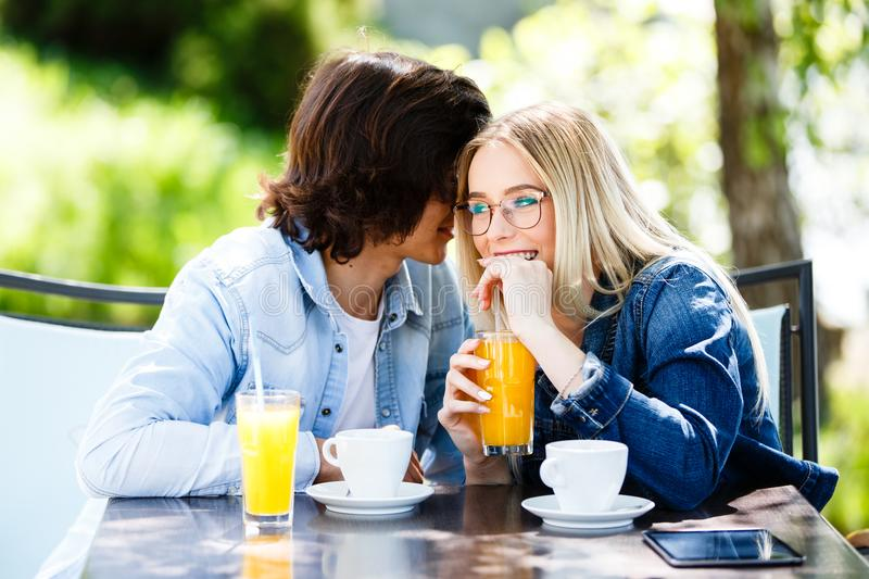 Young romantic couple spending time together - sitting in cafe`s stock image