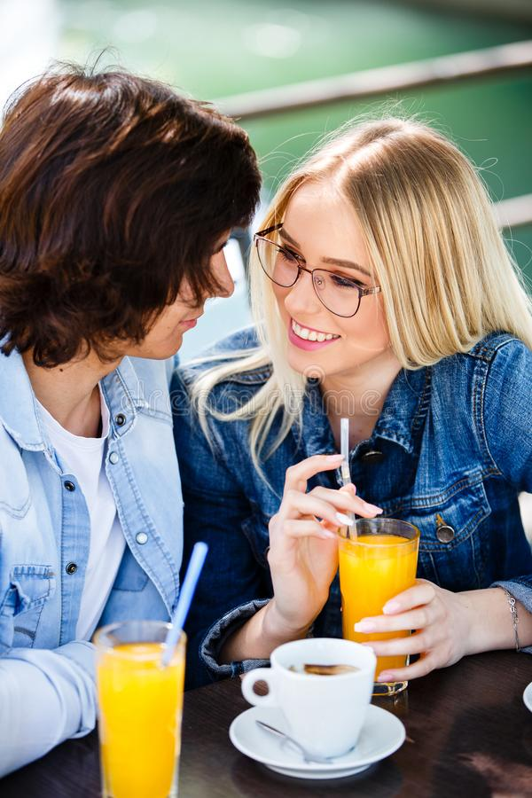 Young romantic couple spending time together - sitting in cafe`s stock photography