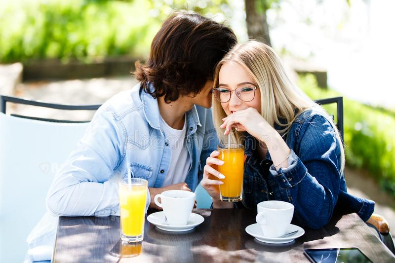 Young romantic couple spending time together - sitting in cafe`s royalty free stock image