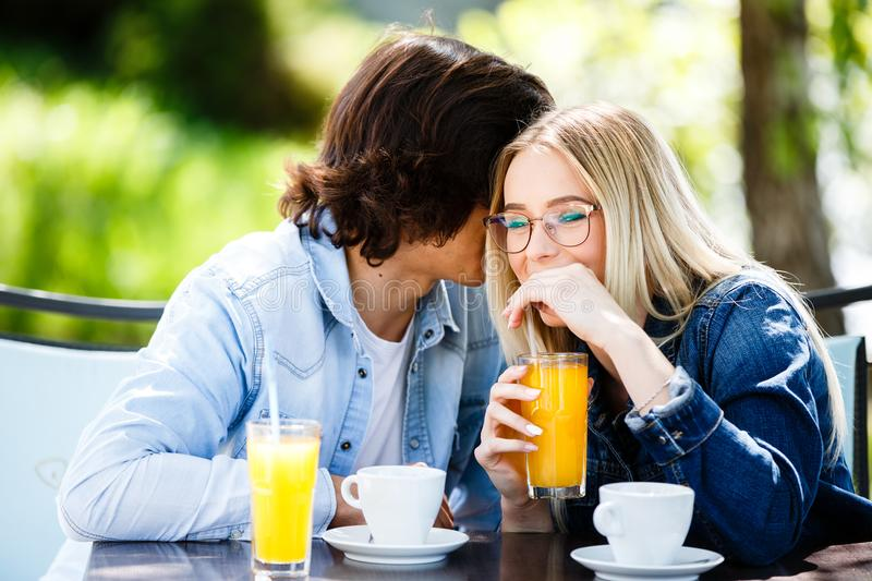 Young romantic couple spending time together - sitting in cafe`s stock photo